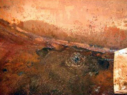 Storage tank corrosion ripples.jpg